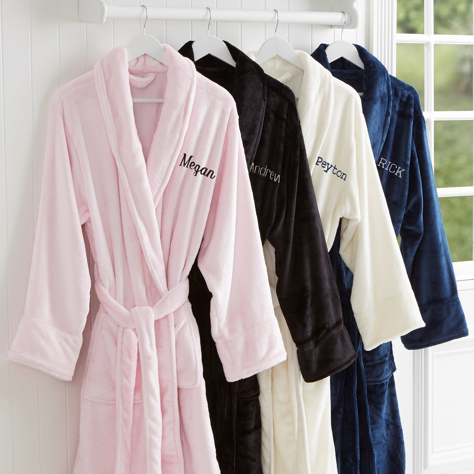 A pink, black, white, and blue robe with names embroidered on the left chest