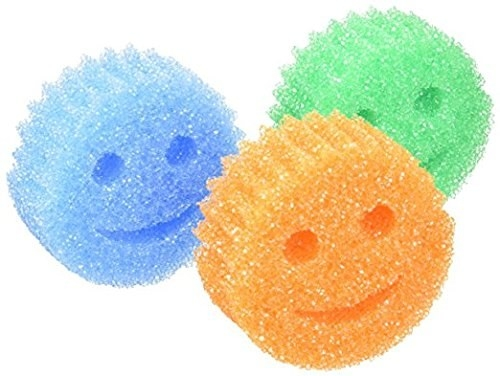 three face-shaped sponges with eyes and mouth shaped holes for cleaning utensils