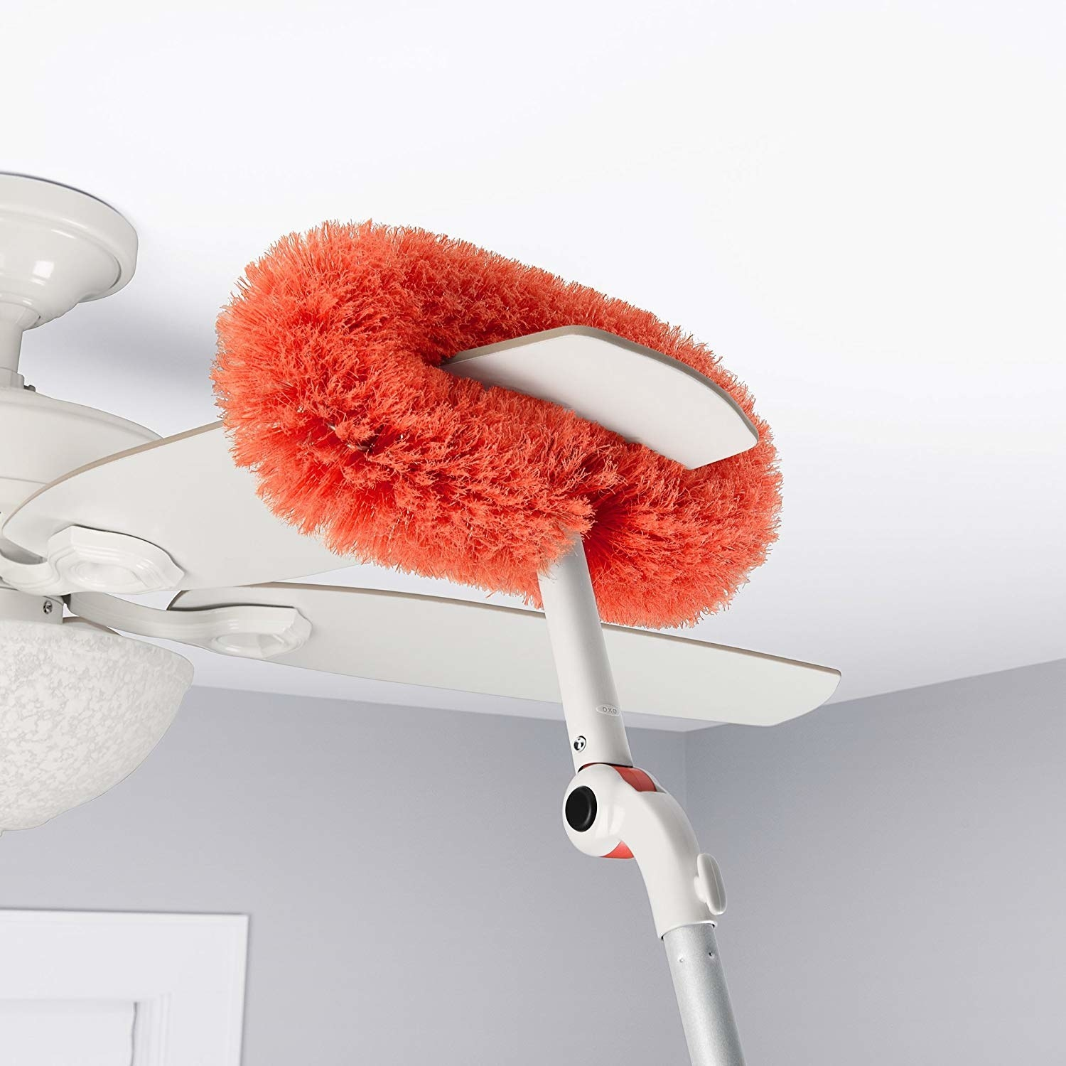 microfiber long reach duster cleaning a blade of a ceiling fan