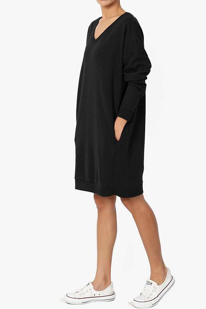 """Promising review: """"A nice weight and super comfy. The V-neck is a little bigger than I realized, so I might wear it with a tank top. The pockets are discreet and don't bulge out like some other inexpensive dresses I've bought on Amazon. I'd say an XXL is a 16-18. It's not going to give you any shape, but it's a sweatshirt dress, what do you expect?"""" —EBPrice: $12.99+ (available in sizes S-3XL and in 26 colors/styles)"""
