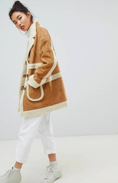 9481e2766b6b4 30. A faux shearling coat that ll make you look like someone who could have  been plucked straight out of a Bob Ross painting.
