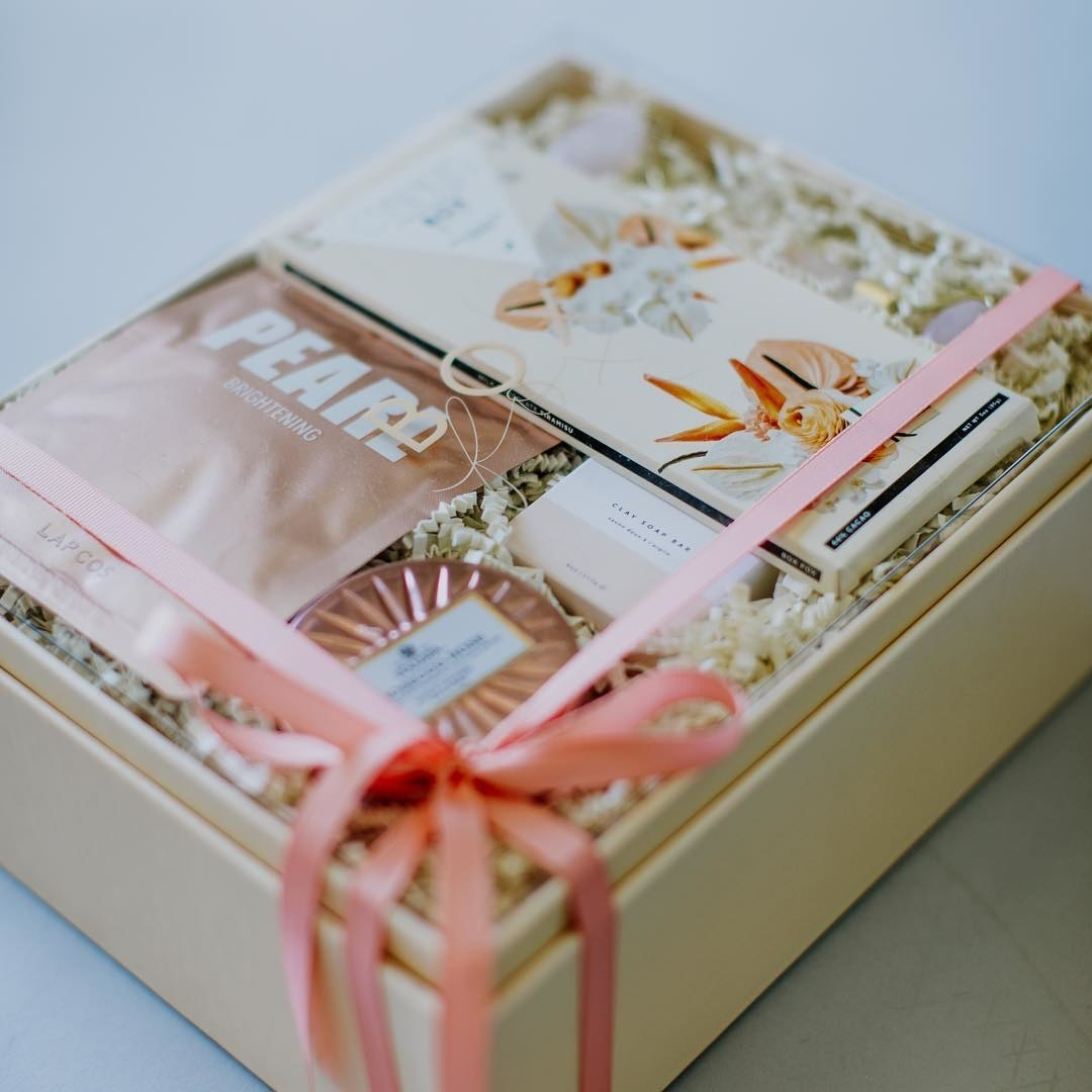 pretty box with items and shredded paper in it
