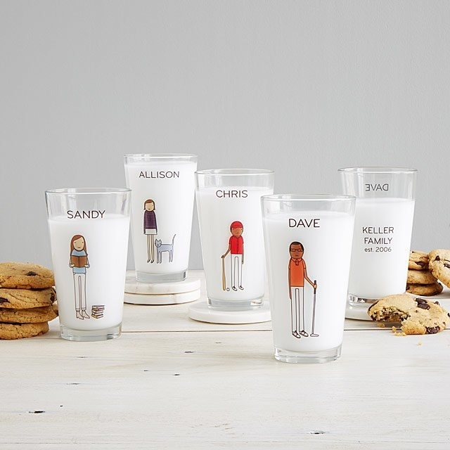 Pint glasses with illustrations of people reading, golfing, playing baseball, and having a cat