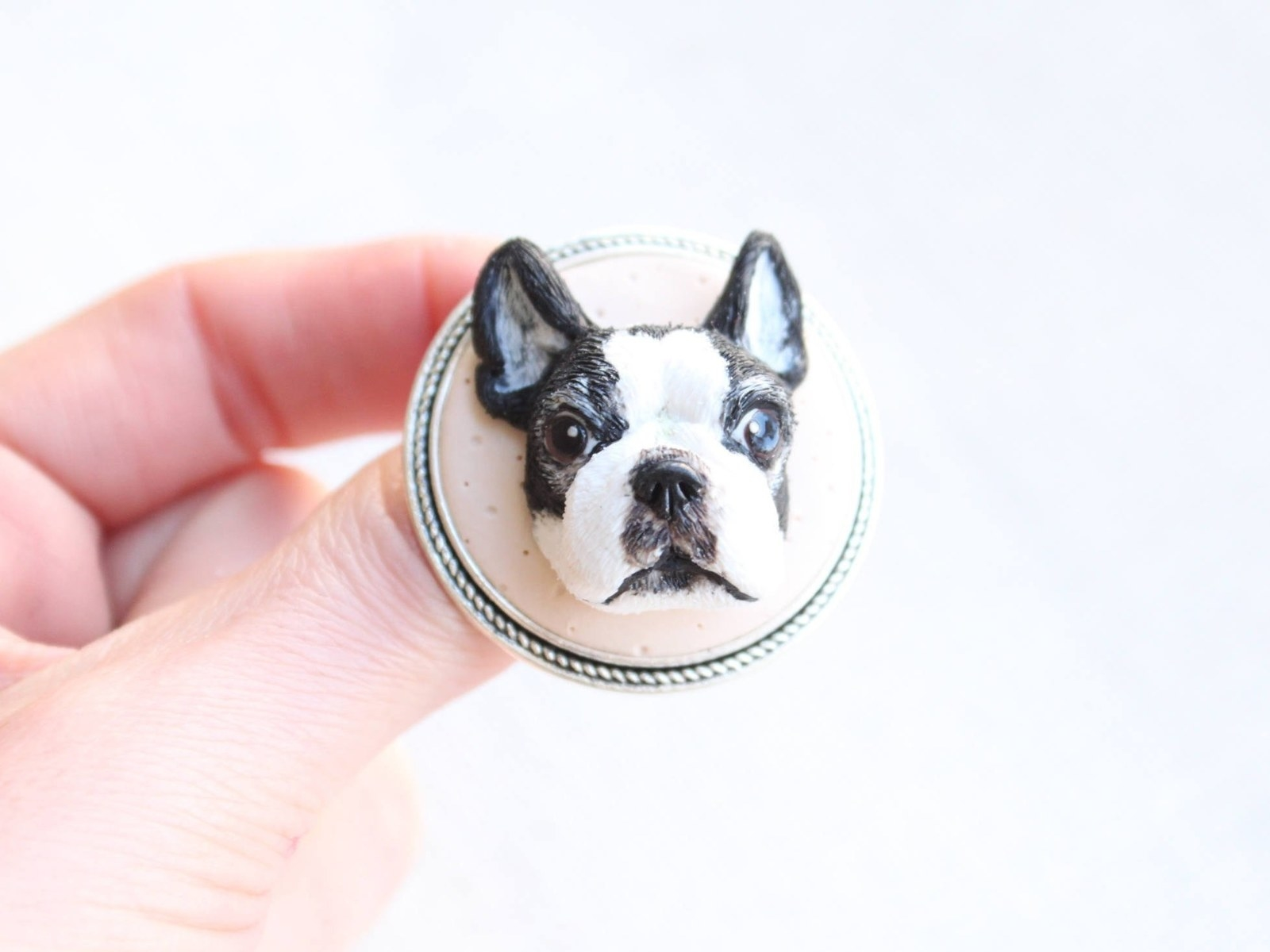 3d dog face figure on ring