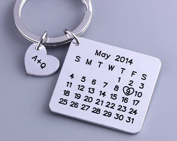 calendar charm with extra small heart charm with initials on it