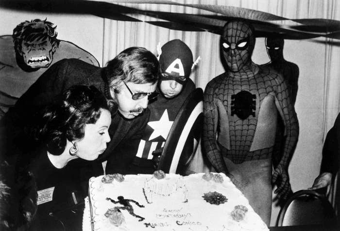 Mighty Marvel comic book publisher Lee (second from left) and his wife, Joan (far left), blow out the candles on the Marvel Comics birthday cake at opening day ceremonies of the first-ever Mighty Marvel Comic Book Convention on March 22, 1975, in New York.