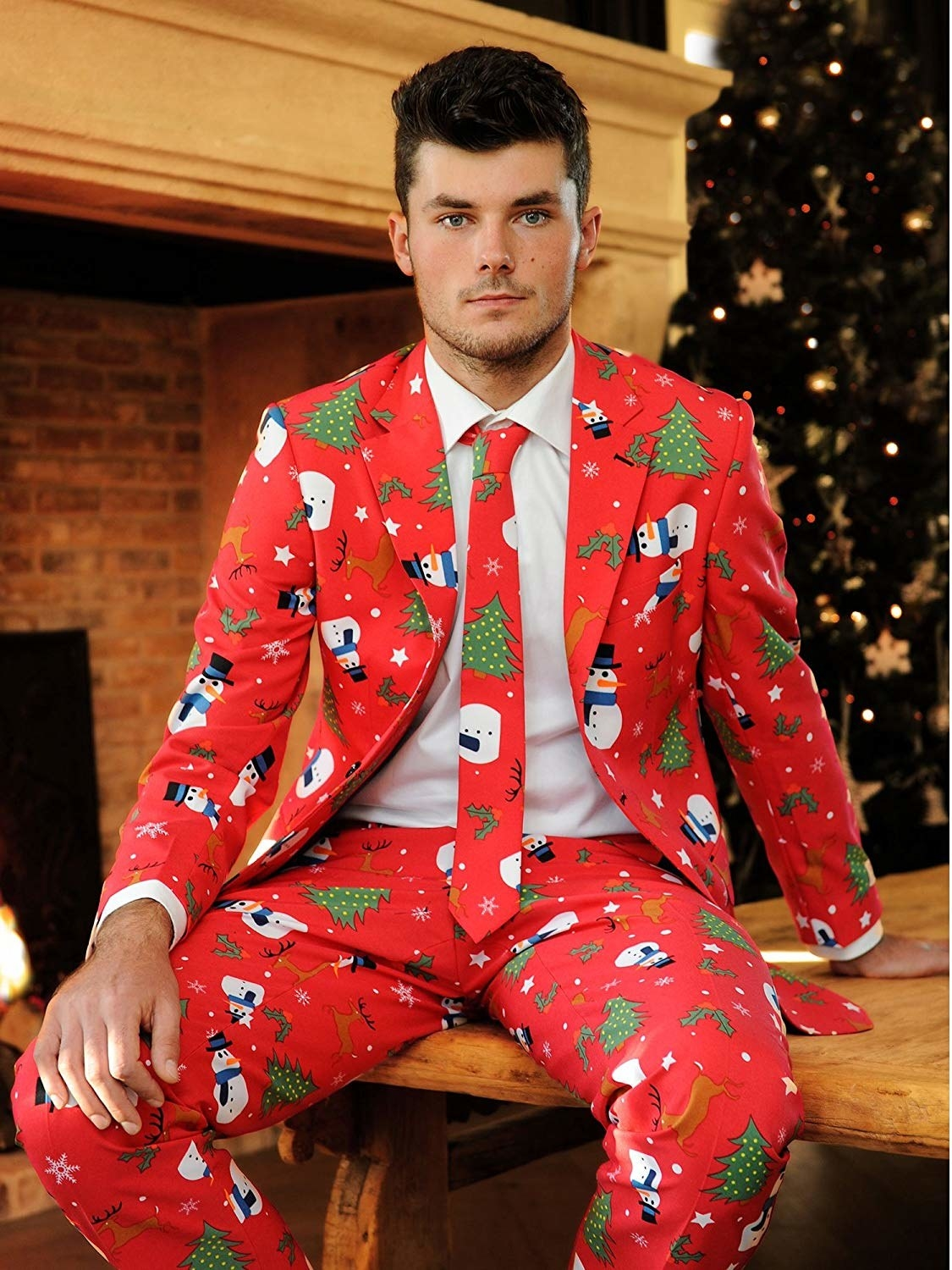 Model in the red suit with a snowman and christmas tree print