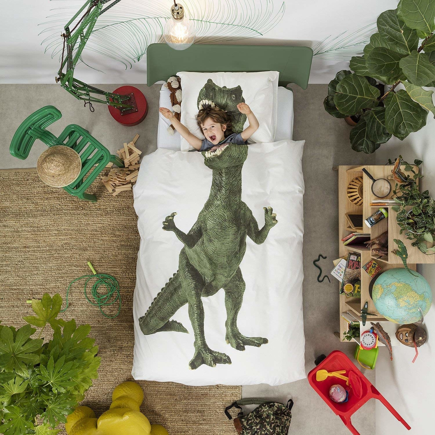 The set with the body of a dinosaur on the duvet and the head on the pillowcase to make it look like it's eating the child under the covers