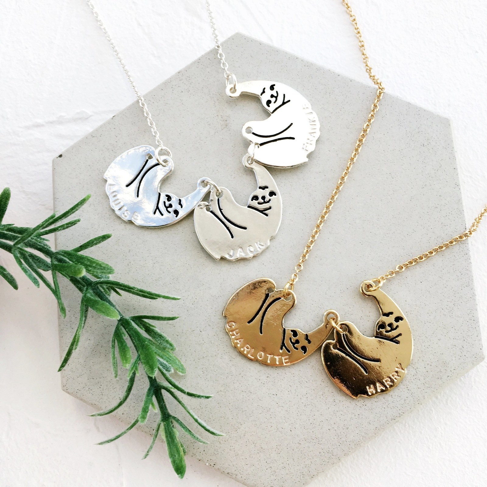necklace with sloth charms that have engraved names