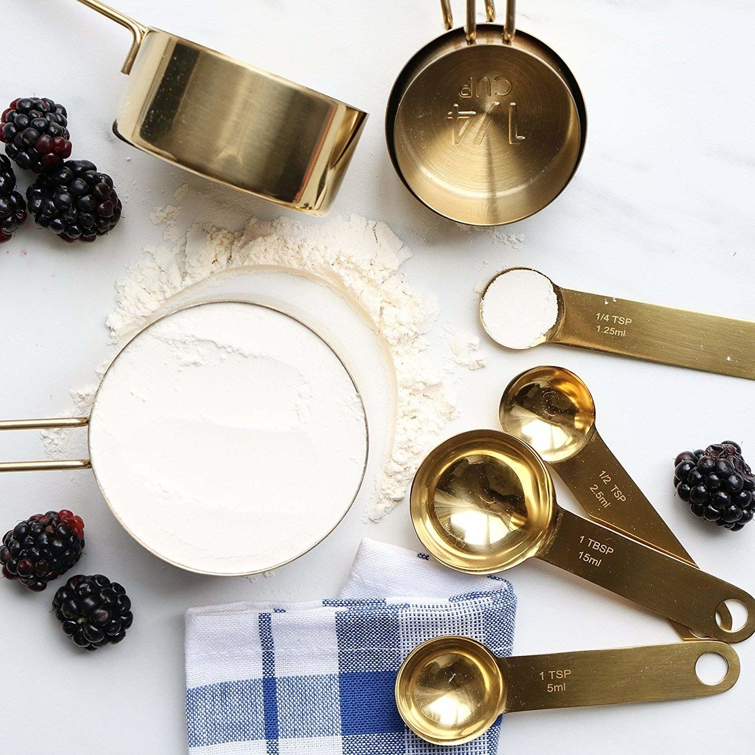 gold tone measuring cups with engraved sizes on them