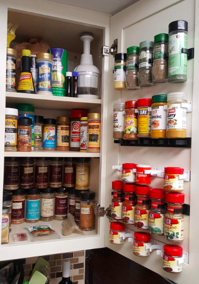 Sets of spice-gripper clips hanging on the inside of a cabinet door