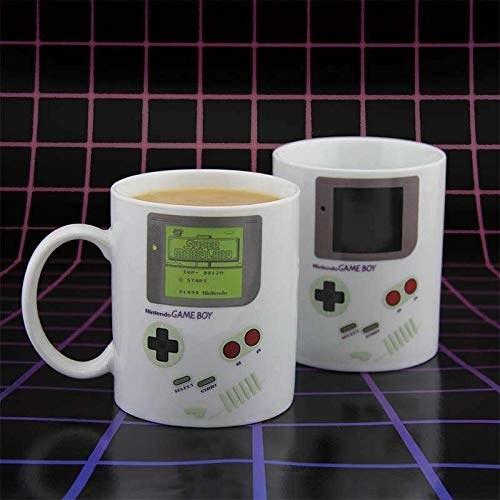 """two mugs, one with liquid and a """"lit"""" screen and one empty with a dark screen"""
