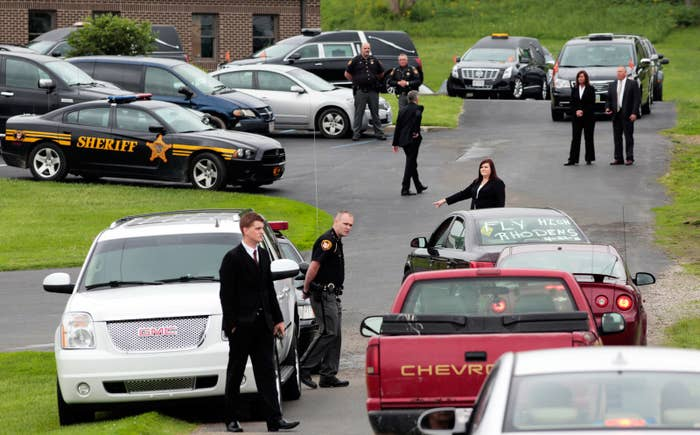 Mourners arrive to attend a funeral for members of the Rhoden family who were shot to death in rural Ohio in 2016.