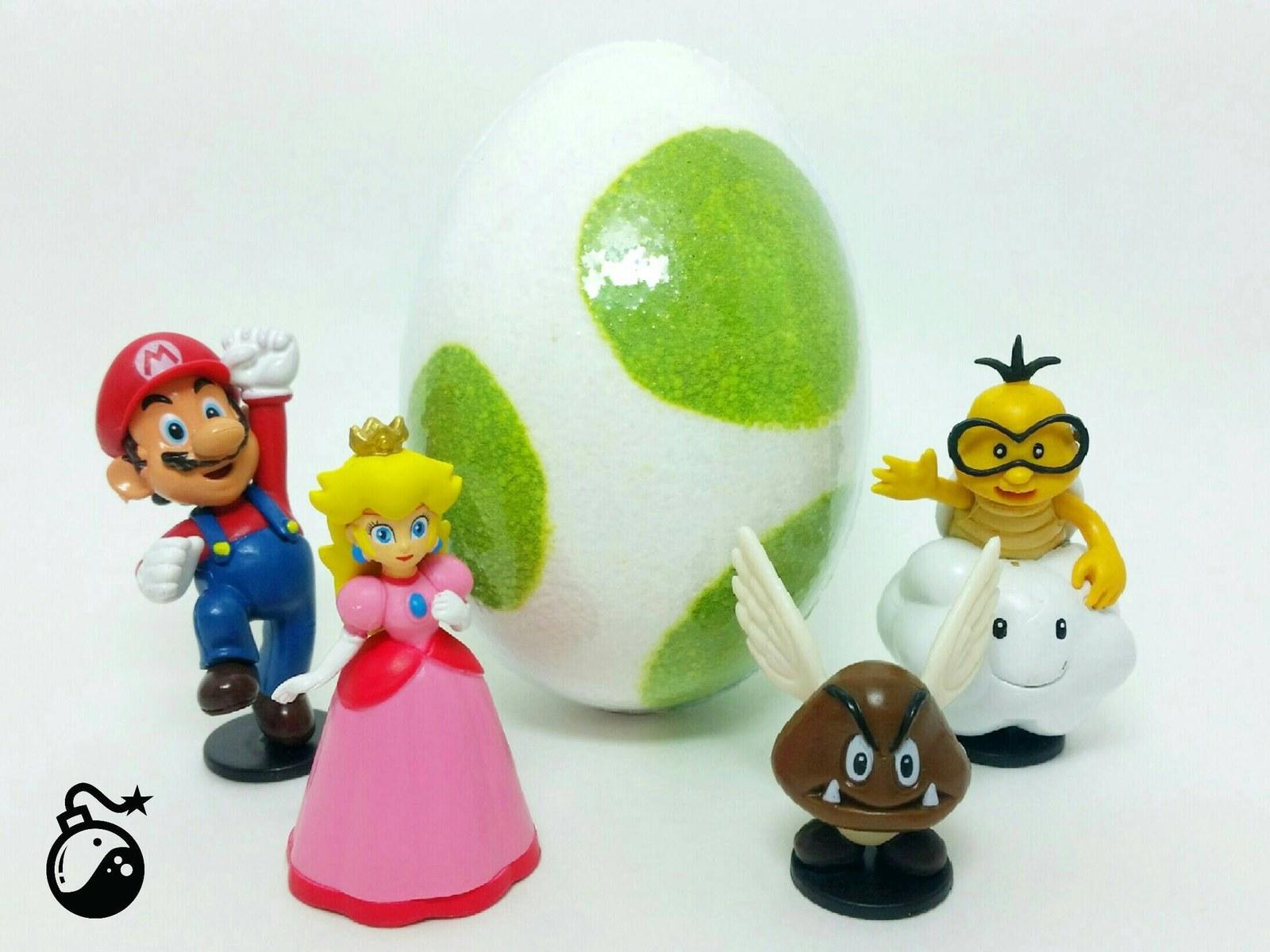 various nintendo character figures in front of yoshi egg bath bomb