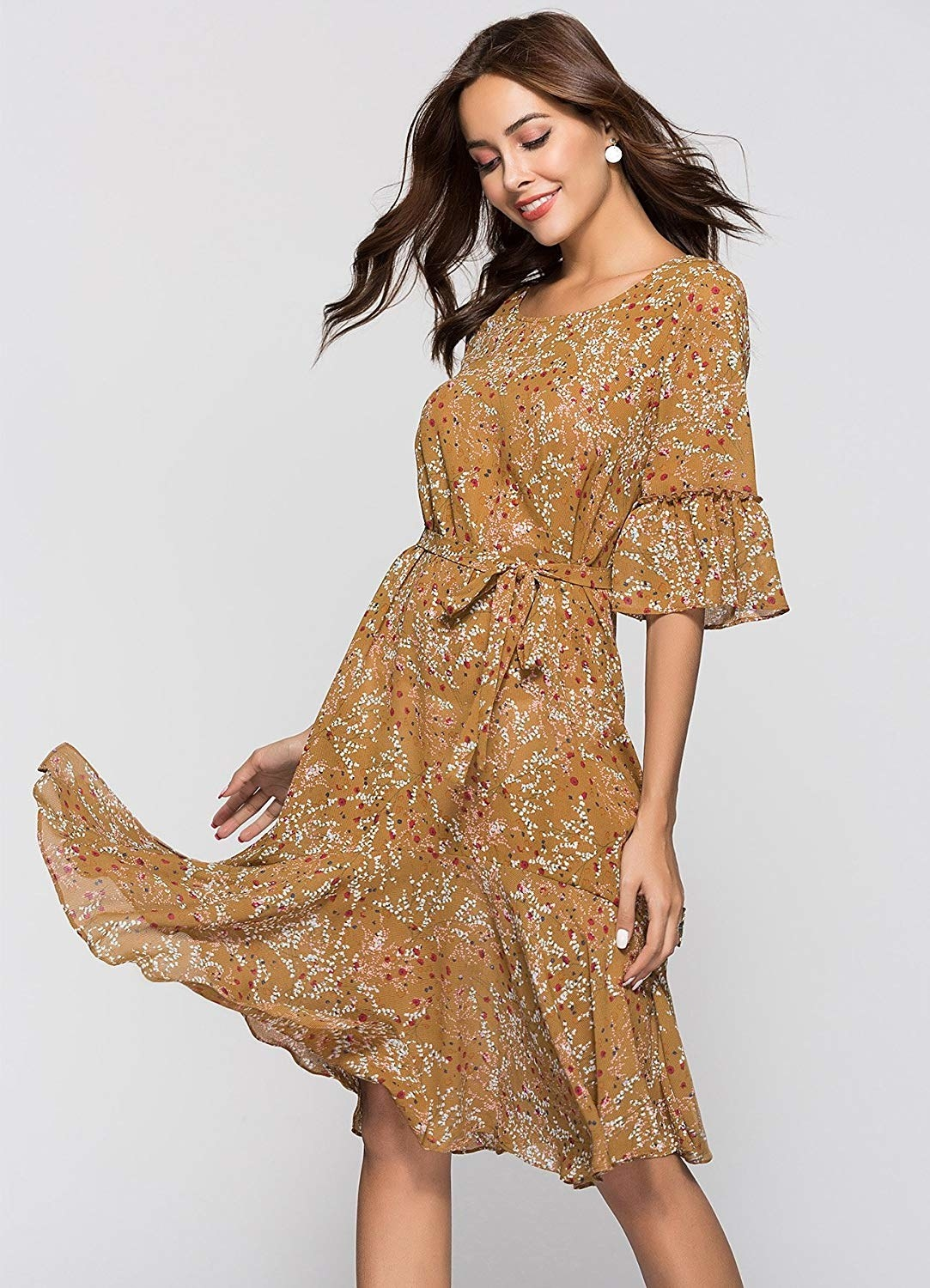 model wearing light brown floral print dress