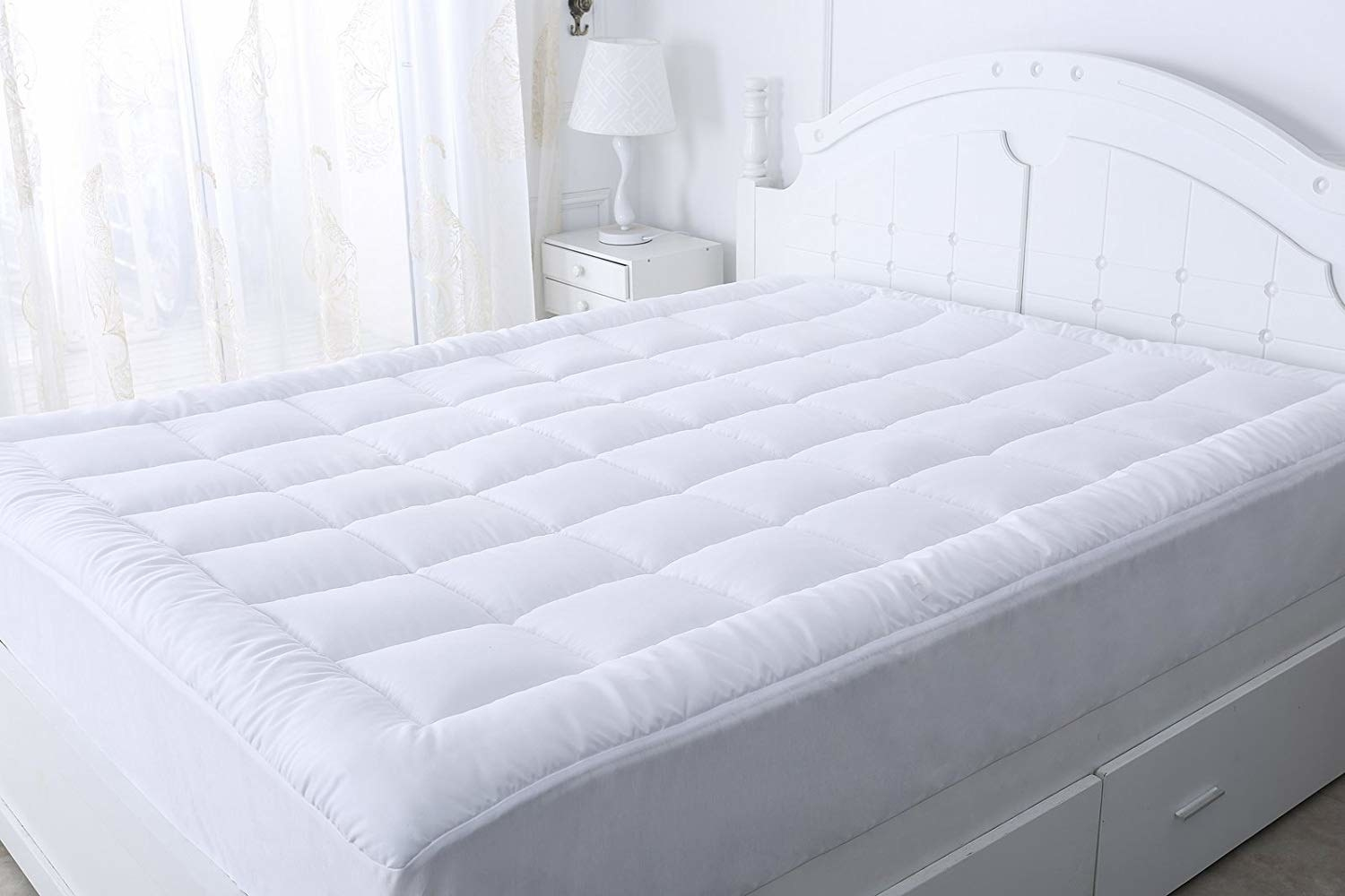 Deep-pocket mattress topper in white on bed