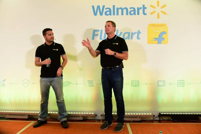 Flipkart cofounder and CEO Binny Bansal (left) next to Walmart CEO Doug McMillon in Bangalore.