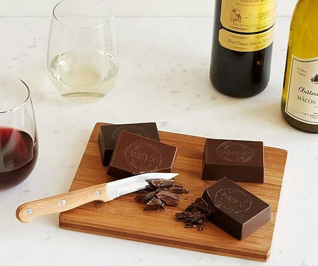 Includes four 3 oz. chocolate bars (extra dark chocolate, medium dark chocolate, smooth dark chocolate, and milk chocolate), a wood cutting and serving board, a stainless steel serving knife, and a tasting guide.Get it from UncommonGoods for $50.
