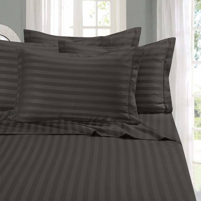 "Promising review: ""I saw these sheets and had to try them because my bedroom is purple and gray. I have a queen size bed and the sheets fit perfectly. The pocket corners of the fitted sheet stay on and I really like that. It is annoying when the fitted sheet does not stay on! I love the softness and they are very cozy. They have held up well in washing, and so far the color has not faded."" —A.C. Get them on Amazon, $22.99+ for a queen set (available in full through California king, 13 colors)."
