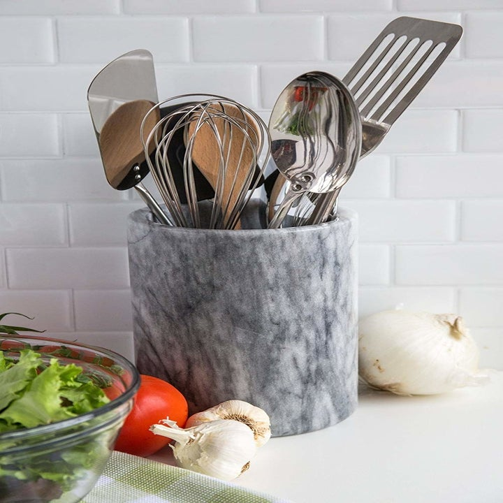 The marble option holding at least 7 large cooking utensils