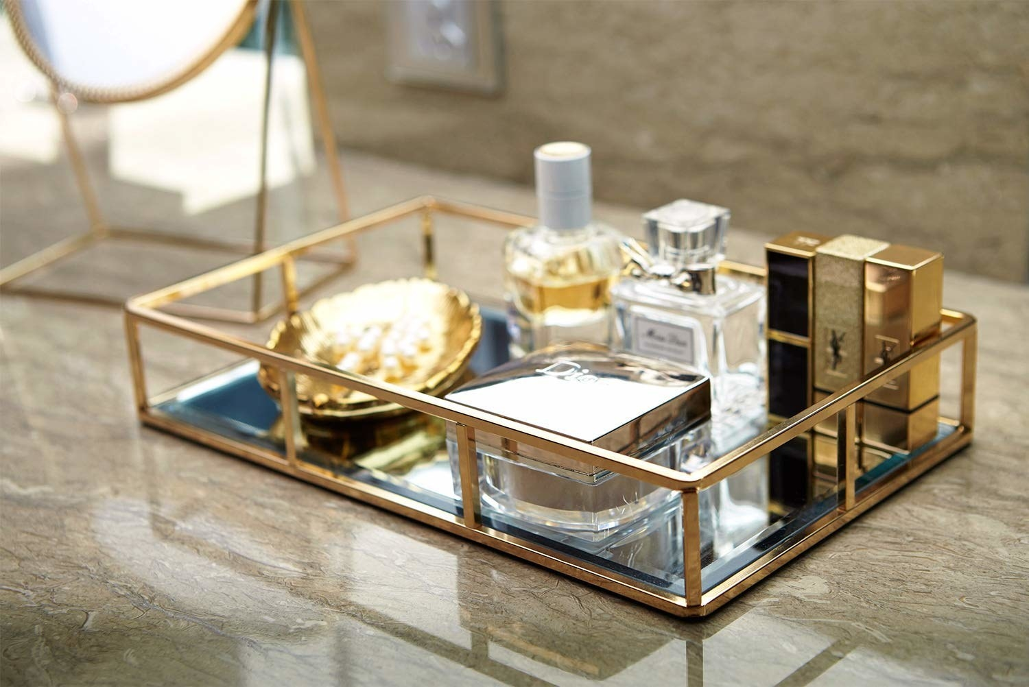 Rectangular tray with two-inch gold railing around the sides, so you can see the cosmetics on it easily