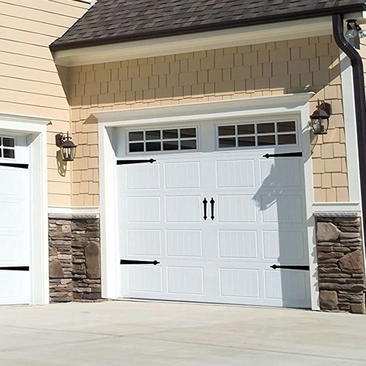 white garage door with four hinges and two handles