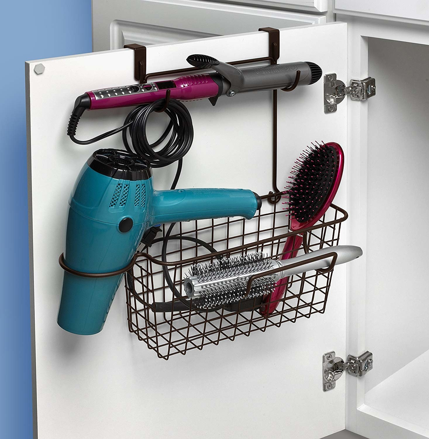 storage basket with hooks for a curling iron, a round slot for a hair dryer, and a loop for a round brush
