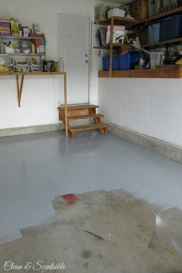 blogger's garage floor, 75% covered in uniform grey paint that hides stains, spray paint overspray, and other mess on the concrete