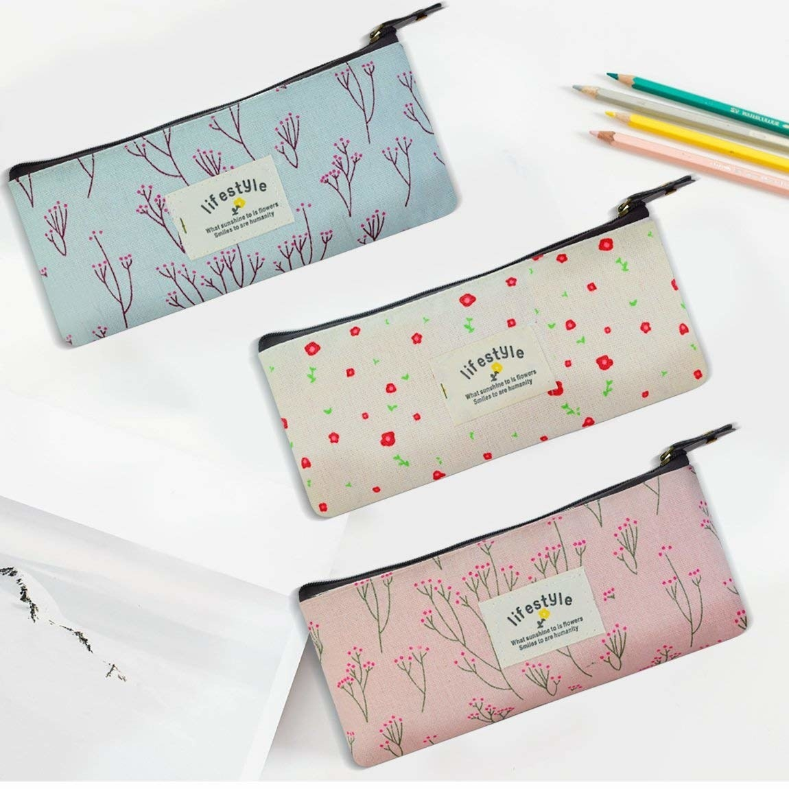 three floral printed zippered pouches