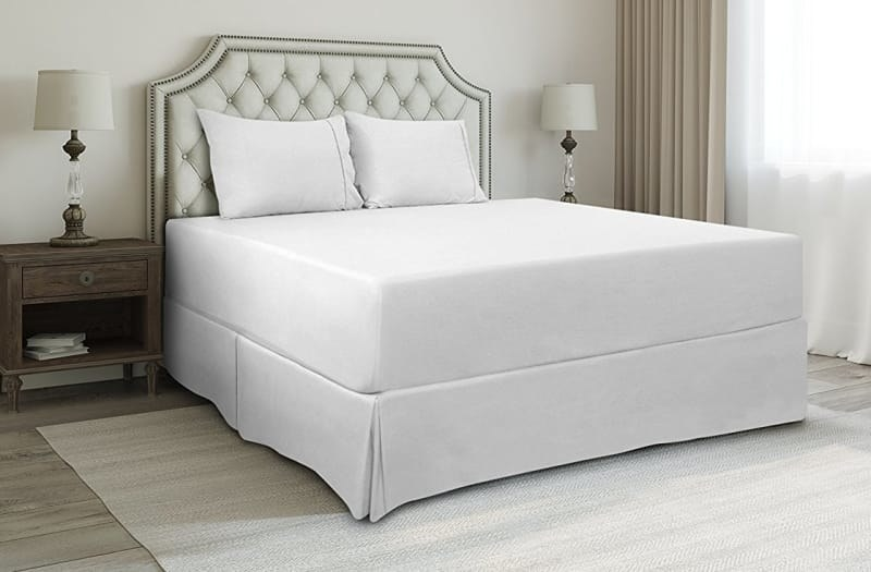 A simple white bedskirt on a bed