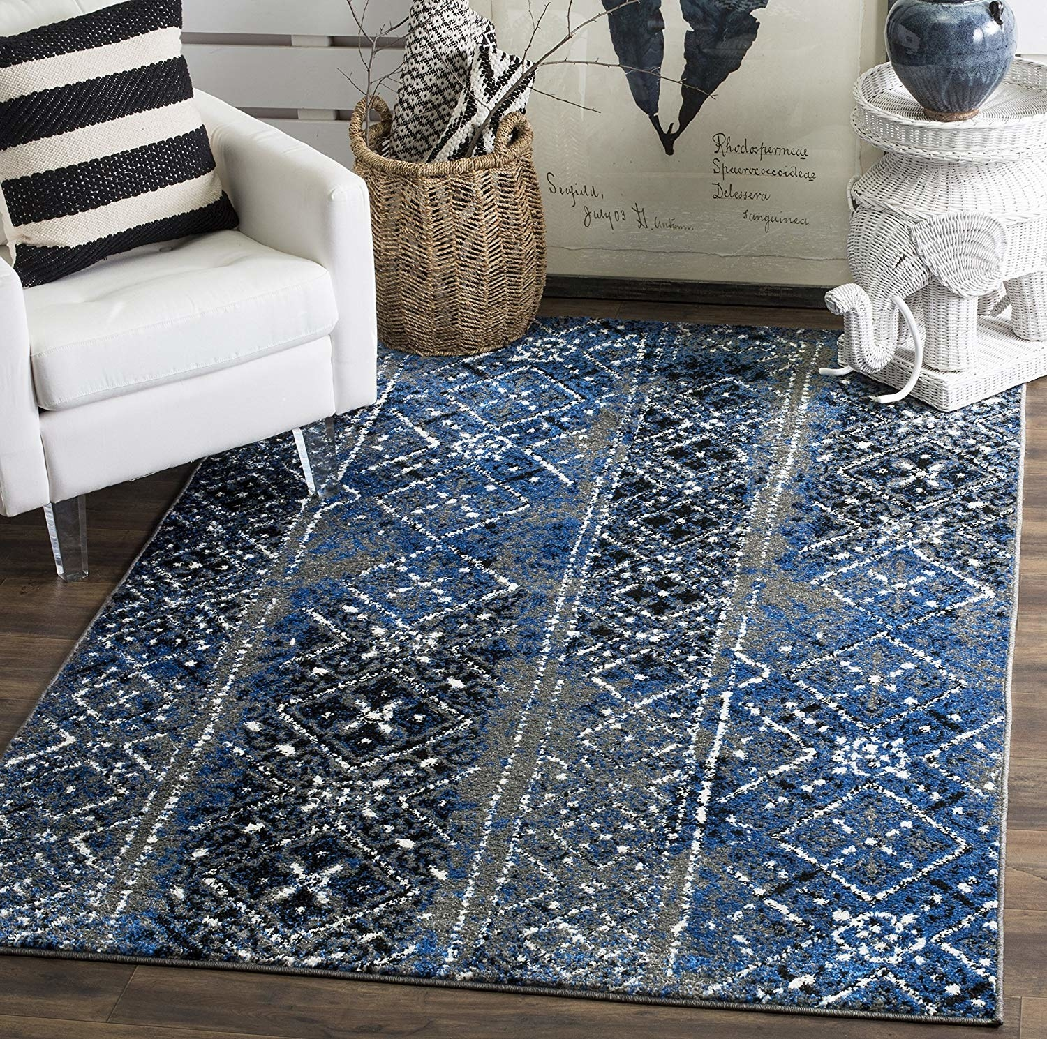 blue and grey diamond and dot patterned rug with white accents
