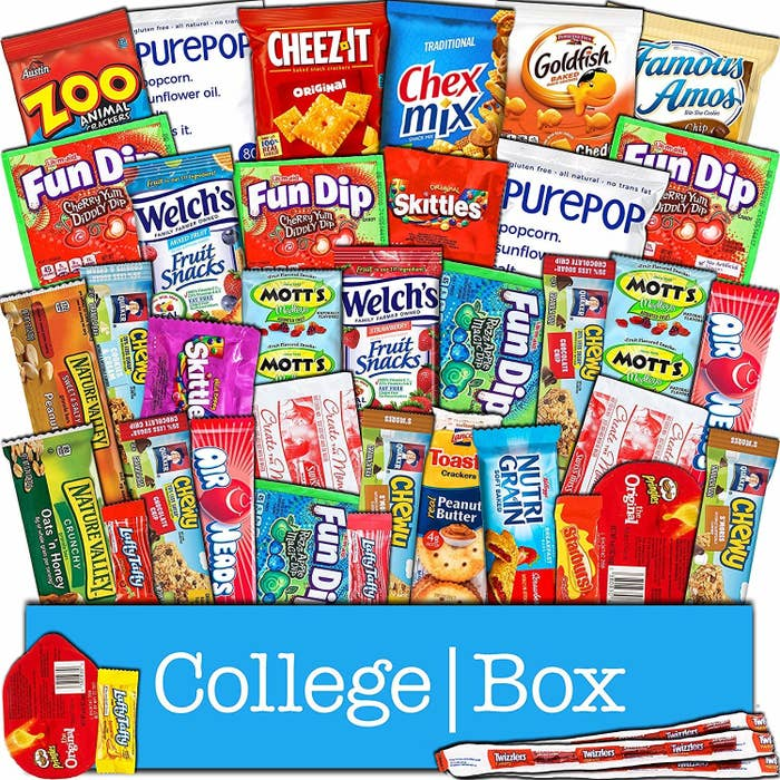 various snacks like candy, granola bars, fruit snacks, and chips in a college box