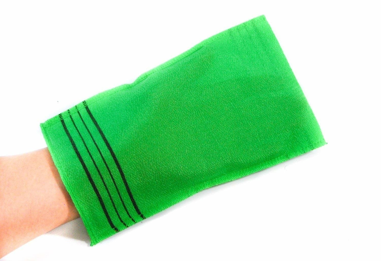 green washcloth on a hand