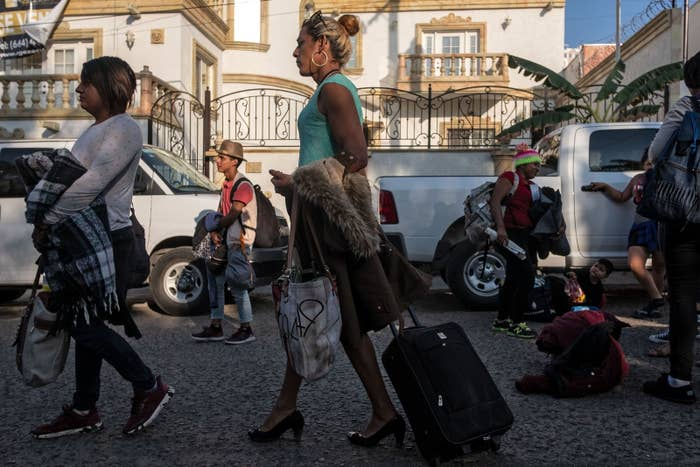 Members of the LGBT community who split from a caravan of Central American migrants heading to the US arrive in Tijuana.
