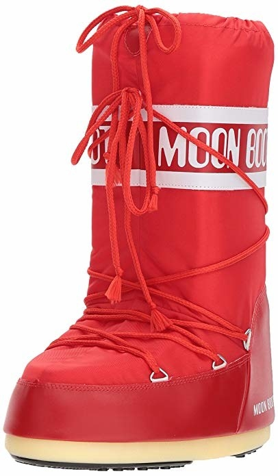 "the boot in red with string and white ""Moon boot"" written in a circle about mid calf"
