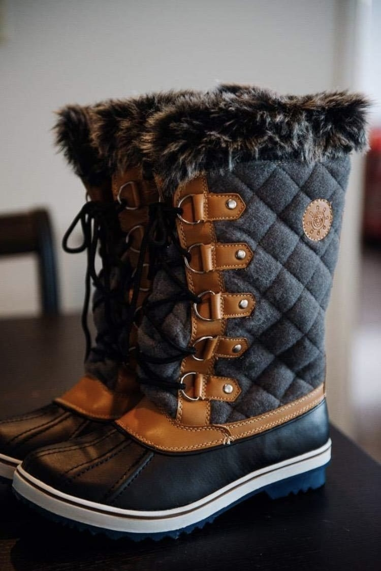 reviewer pic of the boots in black and brown