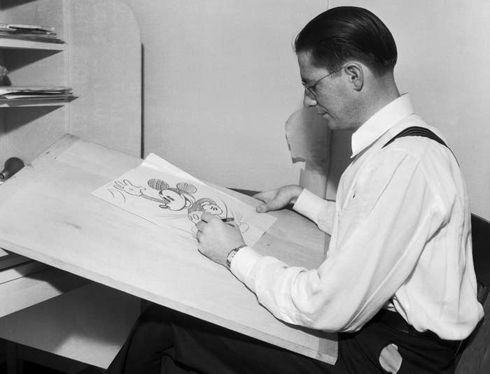 Cartoonist Floyd Gottfredson making a drawing of Mickey in the studio, 1933.