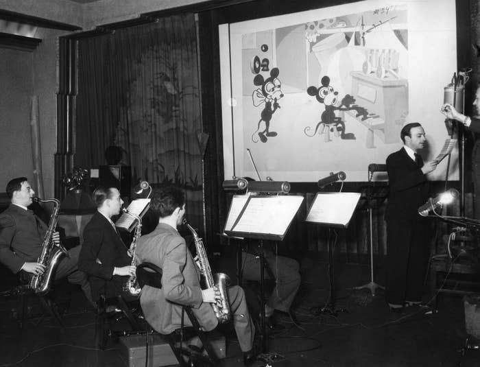 A group of musicians record sound for a Mickey Mouse cartoon, 1932.