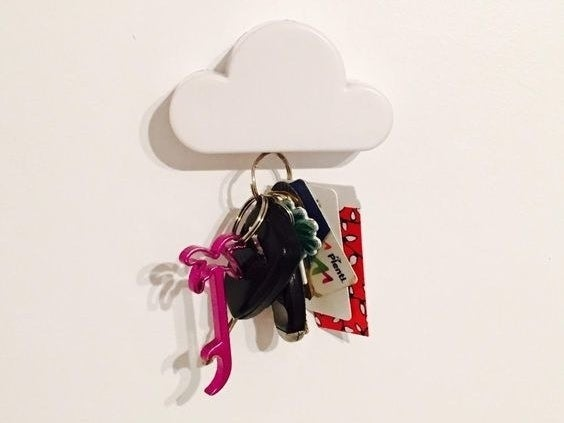 The cloud on a wall with a keychain hanging from it