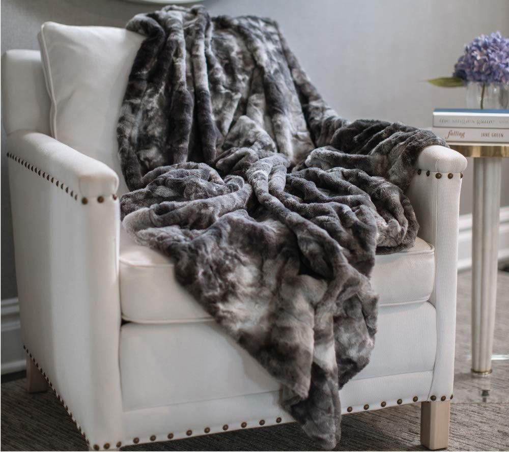"""Having a blanket or warm pajamas also helps."" —atthemomentnecessarystuffGet this washable faux-fur throw on Amazon for $22.99."