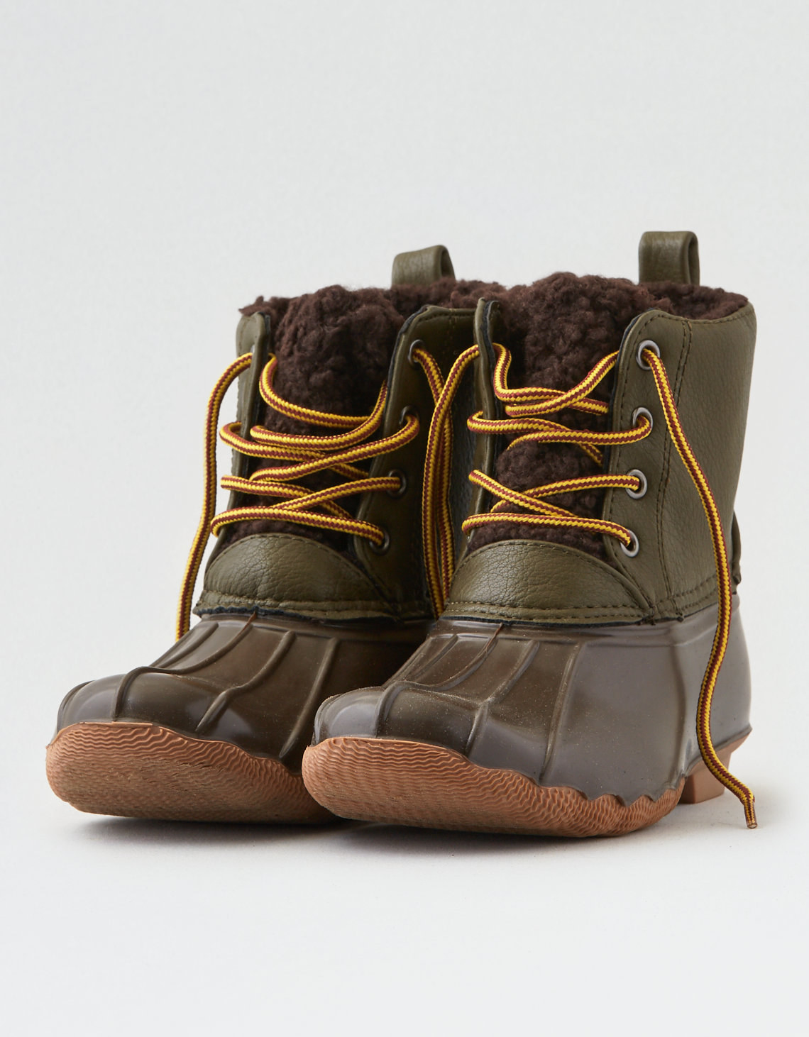 the duck boots in brown and olive green with yellow laces