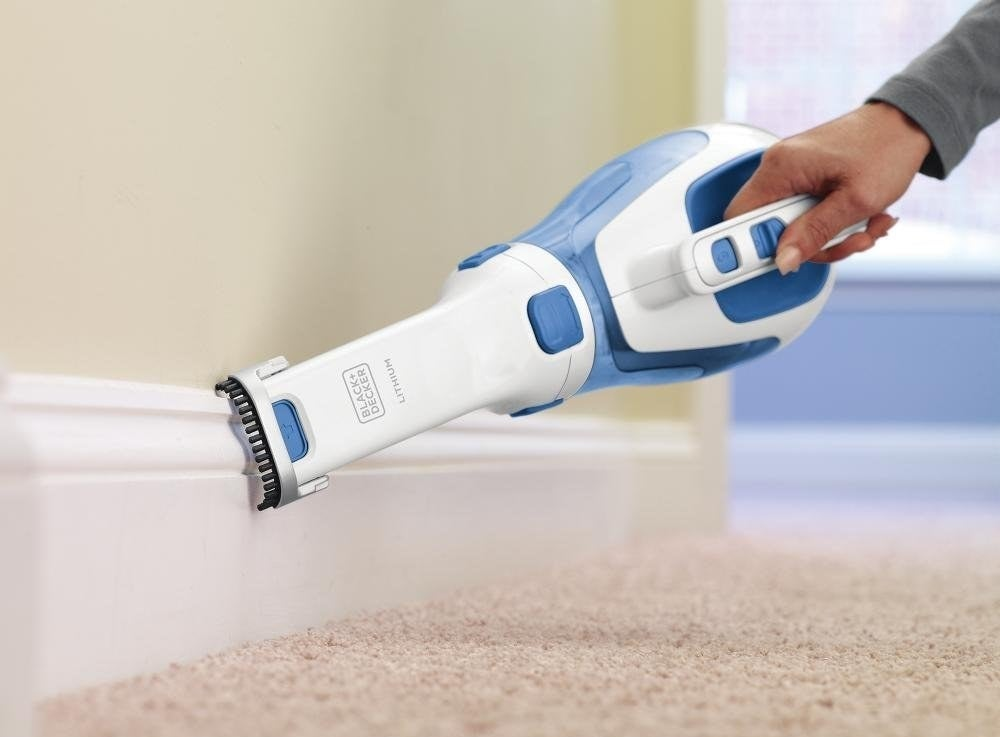 the vacuum cleaning baseboards