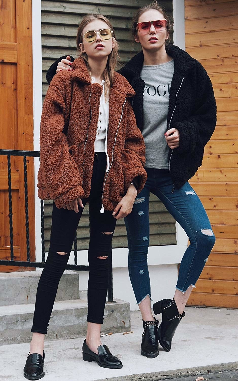 Two models in the black and brown zip-front jackets