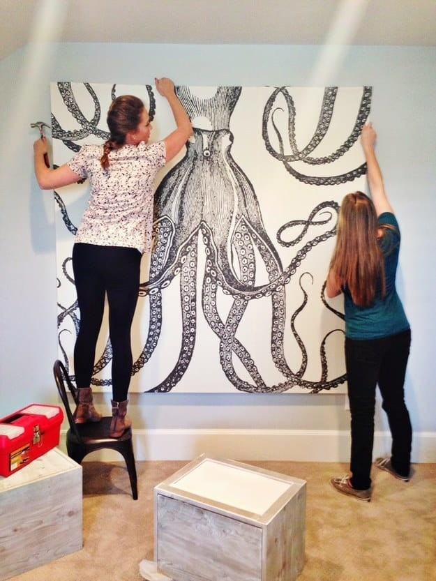 Bloggers at House of Jade Interiors hanging oversized Octopus art