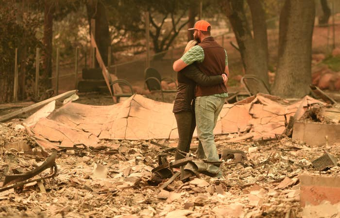Chris and Nancy Brown embrace while looking over the remains of their burned residence after the Camp fire tore through the region in Paradise, California, on Nov. 12.
