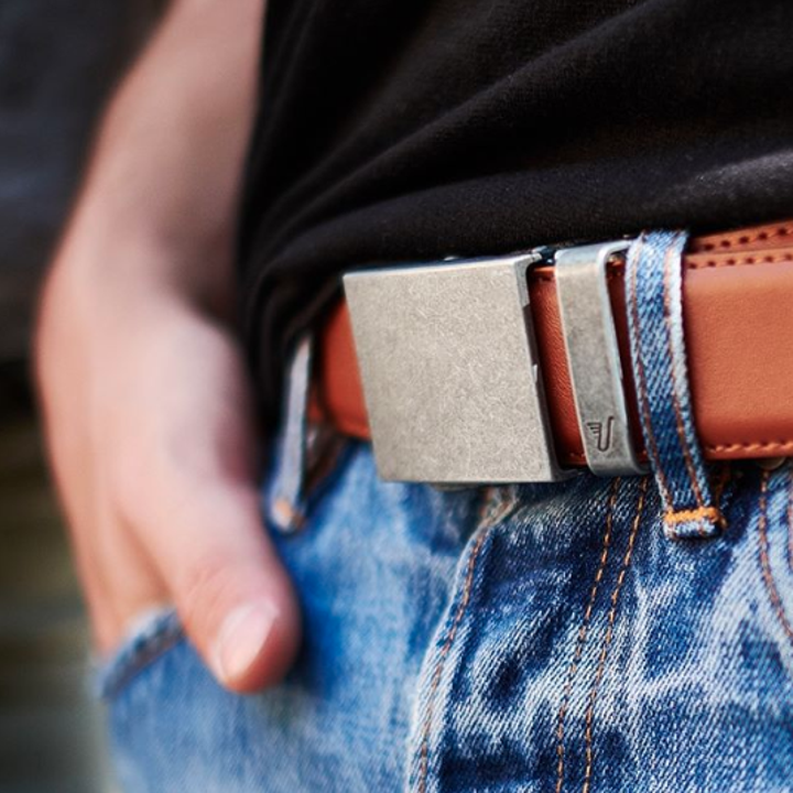 Model wearing the brown belt with a rectangular metal buckle