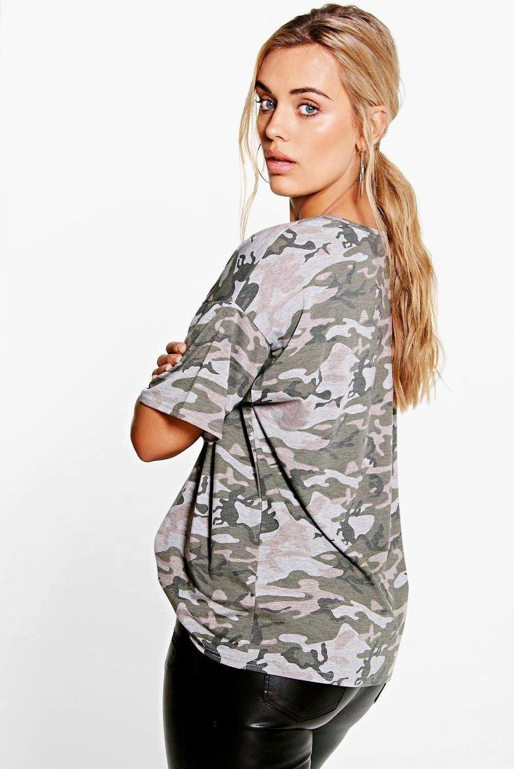 A model wearing the camo tee