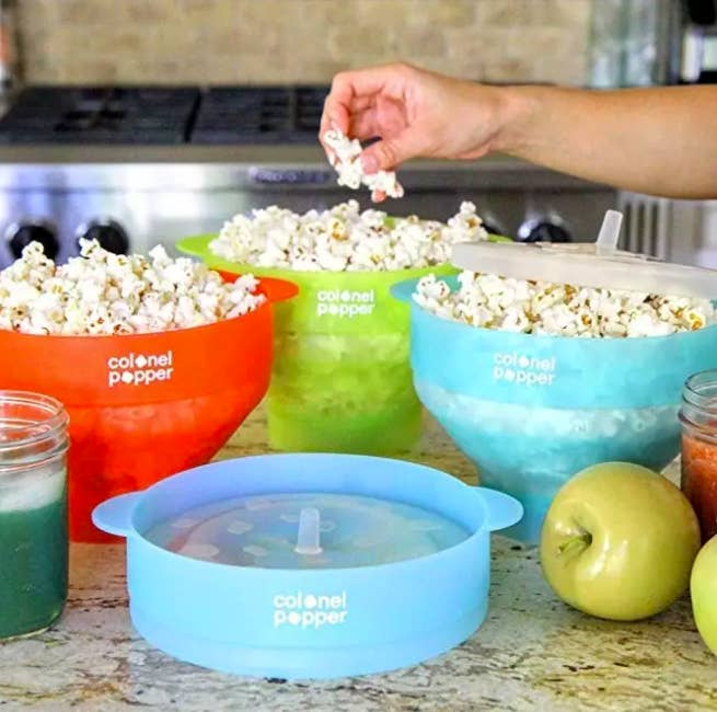 """The Colonel Popper is made of BPA-free silicone and is dishwasher-safe. No fuss! No frill! Just popcorn.Promising review: """"This popcorn maker works great! My microwave is rated at 1200 watts with a glass turntable. I measure 1/4 cup of regular store brand popcorn, dump it into the popcorn maker, and put the top on. Next, I place the popper in the microwave and set the timer for three minutes. When the popping sound almost stops, I turn off the microwave. At that time I lift the lid, add a couple dollops of butter, and leave the lid on to melt the butter. When it's all melted, I remove the lid and sprinkle the popcorn with garlic salt and powered cheese (but you can put whatever spices you like). Lastly, I give it a good shake to mix the ingredients and serve the popcorn in the same bowl. I love this thing. It's very easy to use and cleans up easily with soap and water."""" —Bruce AGet it from Amazon for $14.97 (available in seven colors) AND some gourmet popcorn kernels for $7.99+."""