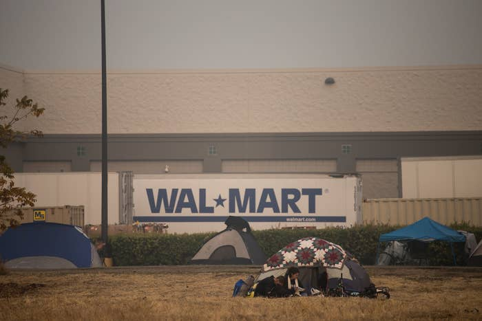 Displaced Butte County residents have set up a makeshift camp nearby a Walmart parking lot, after being displaced by the Camp fire, in Chico, California, Nov. 16.