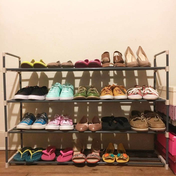Reviewer's four-shelf rack with 20 pairs of shoes lined up on it